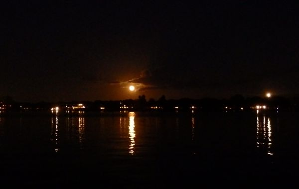 Full Moon in December 2014 (Center) and Light from the Saint Augustine Lighthouse (Right)