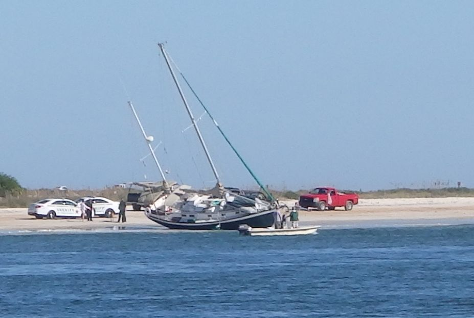 """Other sailboat accidentally ran aground by the Channel.  One hour after seeing this boat, we found our own problem-""""the old windlass system broke a gear off inside"""" (Cost about $5,000 and lots of pain... but more sightseeings in St. Augustine)"""