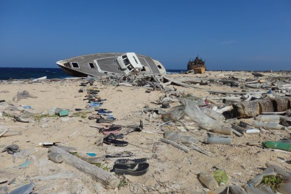 Windward Side of the Island, Sunk Sailboat, Sunk Freighter, and Lots of Plastic Garbage!