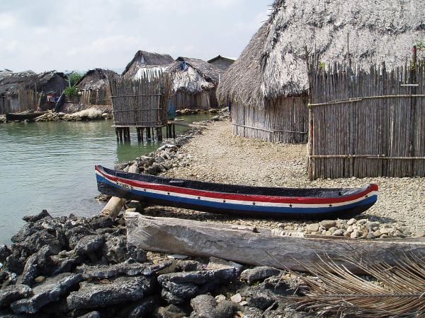 Traditional Guna House and Dugout Boat Called 'Ulu' (Guna Lanauage)