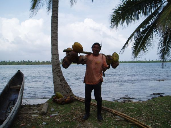 We bought some coconuts from him and also paid for taking his picture. I was informed the Gunas do not like to be photographed  and sometimes they ask for a dollar. He did pose though, notice the machete!