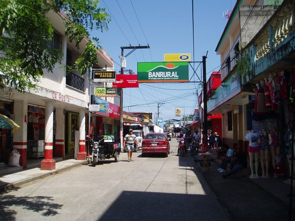 ATM (5B) and Bank (Banrural) Signs on the Main Street in Livingston, Guatemala