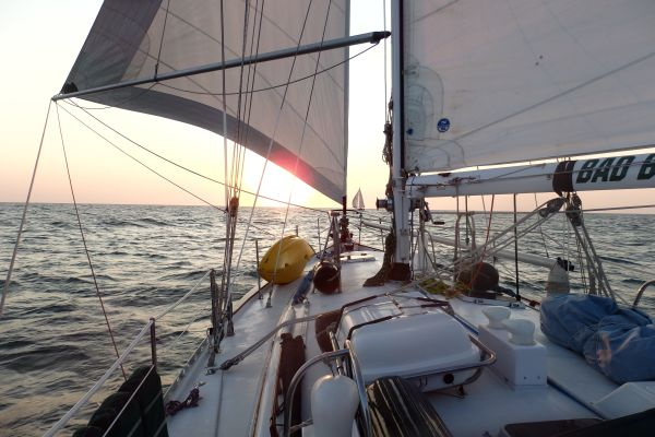 Sailing Wing-on-Wing at Sunrise with Our Friend's Boat 'S/V Ebijmar' in front of us: after Leaving St. Helena Sound near Beaufort, South Carolina, USA
