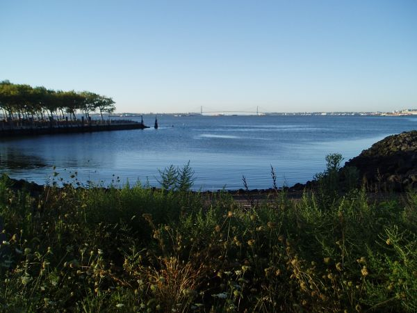 Distant View of the Verrazano Bridge (the Gateway to New York Harbor from the Atlantic Ocean); Picture taken from the Liberty State Park, New Jersey